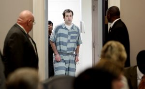 CHARLESTON, SC - SEPTEMBER 10: Former North Charleston officer Michael Slager (C) is lead into court for a bond hearing at the Charleston County Court House September 10, 2015 in Charleston, South Carolina. Slager is charged with the murder of Walter Scott. Slager shot Scott in the back when Scott ran away during a traffic stop on April 4th in 2015. (Photo by Grace Beahm-Pool/Getty Images)