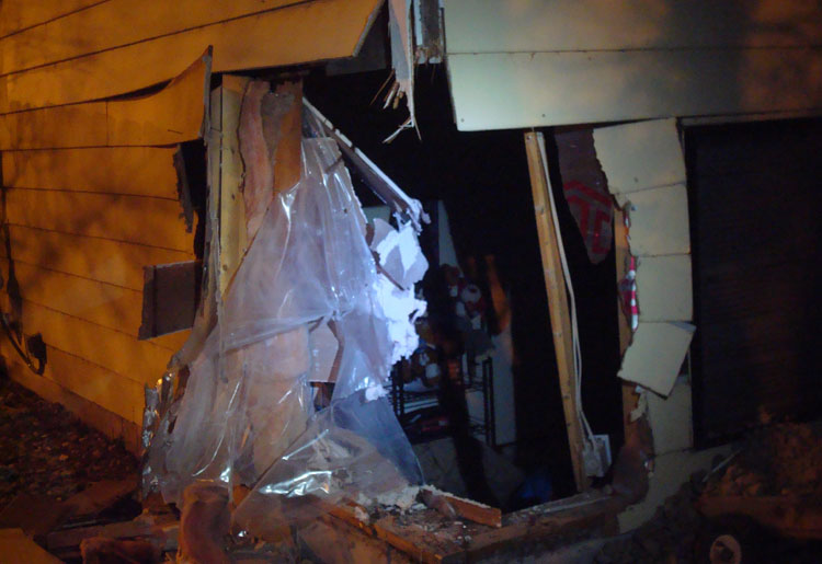 SUV crashes into boys' bedroom, driver flees. Photo by: Kevin Mullen