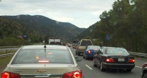 Traffic moved slowly for miles approaching I-70 sinkhole near Idaho Springs, Colo. July 19, 2012