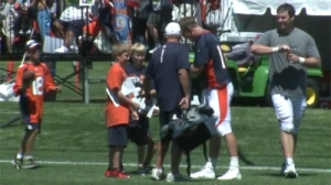 Peyton Manning signs autographs after every practice for 30 minutes.
