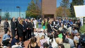 Reporters gather for Arapahoe County district attorney Carol Chambers' press conference