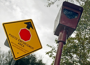 A photo-enforced stop sign camera and warning sign in Topanga, Calif. (CNN)