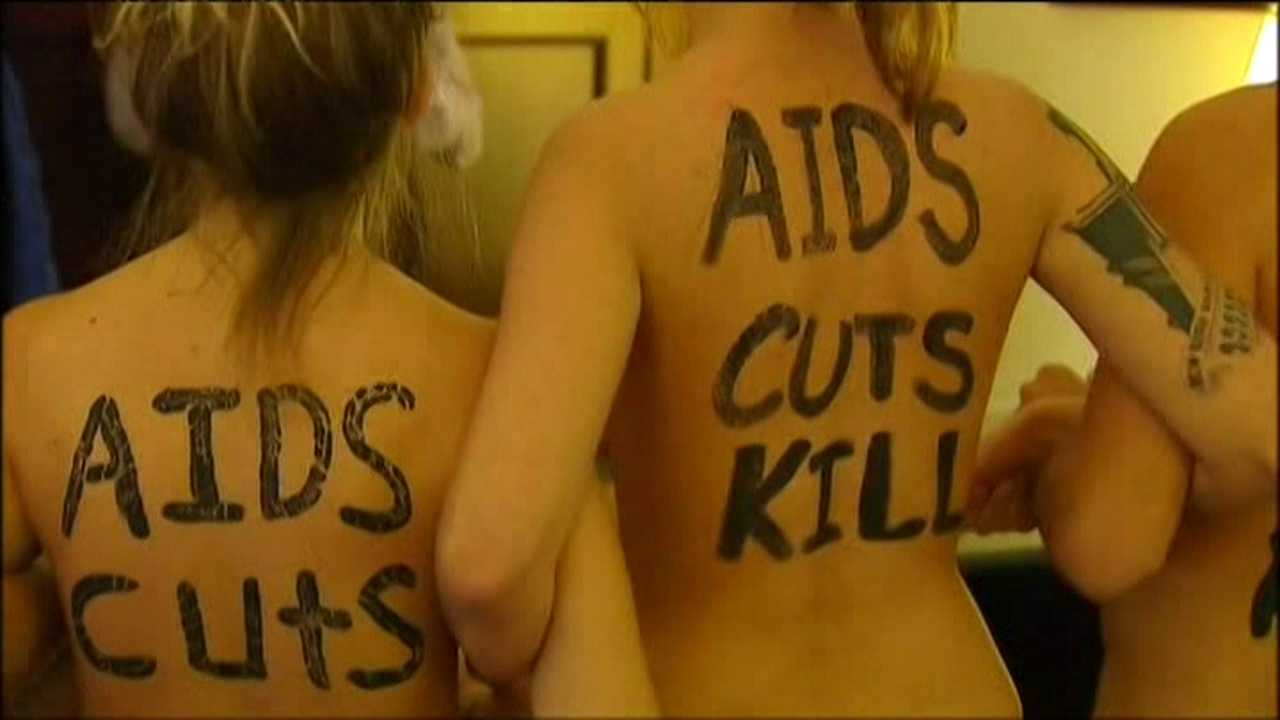 These naked activists work for an organization that works to bring housing opportunities to people with AIDS. (Photo: Fox4KC.com)