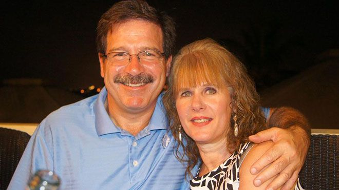 Mark Sherlach and his wife, school psychologist Mary Sherlach, pose for a photo (AP/Mark Sherlach)