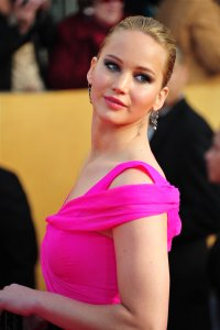 Actress Jennifer Lawrence walks the red carpet at the 17th Annual Screen Actors Guild Awards in Los Angeles.
