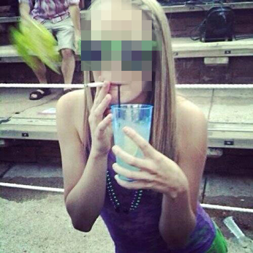 One of the photos posted by the Twitter account @Crunk_Bear, showing a young woman smoking what appears to be a joint. (Photo: Twitter/@Crunk_Bear)