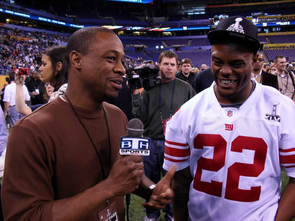 Derrick Martin speaks with a reporter following the New York Giants' victory in Super Bowl XLVI. (Photo: BTH Sports)