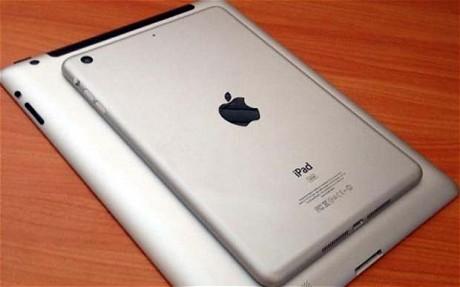The iPad mini is shown on top of a regular iPad.
