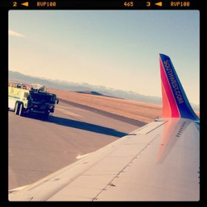 Emergency vehicle approaches Southest Airlines plane at Denver International Airport. Photo: raquelc415 via Instagram