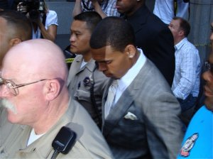 Singer Chris Brown, pictured here in court in 2009, totaled his car Saturday afternoon during encounter with paparazzi. (Credit: CNN)