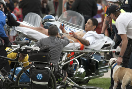 A man is taken away on a stretcher after shots were fired at Denver's Civic Center Park 4/20 rally on April 20, 2013 (Photo courtesy: Daniel Harlan)