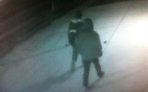 Surveillance images show men pick up gun