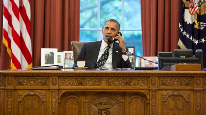 President Obama talks on the phone with Iran's President Hassan Rouhani in the Oval Office on September 27, 2013.