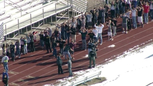 Students are led out of Arapahoe High School during an active shooting situation on Dec. 13, 2013.
