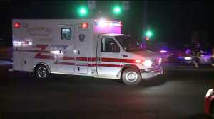An ambulance taking away a person who was hit by a car at Federal and I-76.