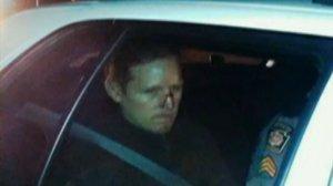 Eric Frein in a police car.