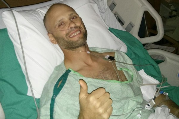 Ofc. Ryan Burns, Aurora Police Department recovers after a suspect shot him