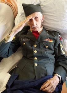 Justus Belfield, 98, salutes in photo taken by Baptist Health Nursing and Rehabilitation Center staff on Tuesday, Nov. 11, 2014. (Credit: WETN)