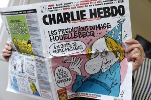 A person reads the latest issue of the French satirical newspaper Charlie Hebdo in Paris on January 7, 2015, after gunmen armed with Kalashnikovs and a rocket-launcher opened fire in the offices of the weekly in Paris, killing at least 12. (Photo: BERTRAND GUAY/AFP/Getty Images)
