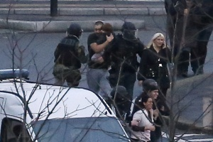 Members of the French police special forces evacuate hostages, including a child, after launching the assault to end a hostage-taking drama at a Jewish supermarket in Porte de Vincennes, eastern Paris. (Photo: THOMAS SAMSON/AFP/Getty Images)