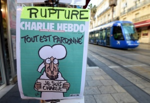 "A tram goes past a sign that translates as ""Charlie Hebdo -- Sold Out"" displayed at a newsagents in Montpellier, France, on Wednesday, Jan. 14, 2015, shortly after the latest edition of the French satirical weekly went on sale. The first issue of satirical magazine Charlie Hebdo to be published since a jihadist attack decimated its editorial staff last week was sold out within minutes at kiosks across France.  (Photo: PASCAL GUYOT/AFP/Getty Images)"