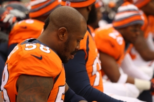 Von Miller reacts on the sideline during the Denver Broncos 24-13 loss to the Indianapolis Colts on Jan. 11, 2014. (Photo: Noah Skinner/KDVR)