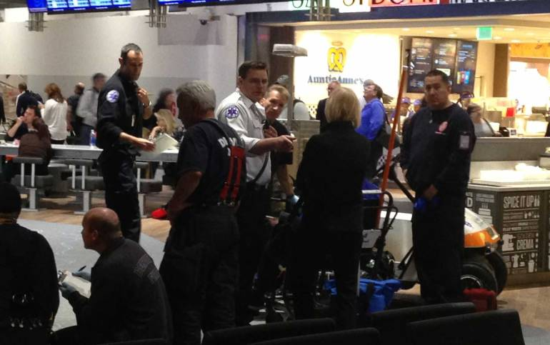Emergency personnel evaluate passengers from Southwest Airlines flight diverted to Denver. Photo credit: Dean Fox