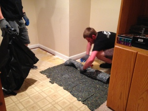 Flood damaged carpet in basement in Aurora, Colo.