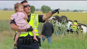 Brighton Police Officer Nick Struck sings to little girl to calm her