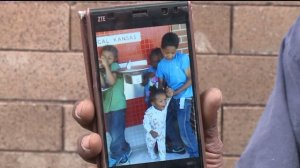 Earl Lampley, grandfather to Javion Johnson, holds up a picture of the 23-month-old who died this morning.
