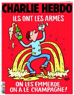 """In the wake of last week's massacre in Paris, Charlie Hebdo, the satirical newspaper has a message that will be heard around the world: """"They got the weapons -- Screw them, we got the Champagne!"""" (Photo: CNN)"""