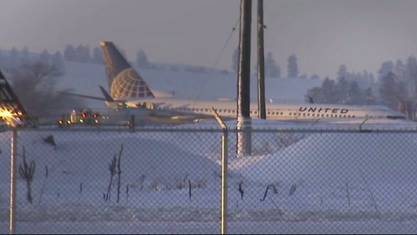 United Airlines Flight 812 bound for Denver slid off the runway and into a snowbank at Spokane International Airport on Tuesday, Jan. 5, 2016.