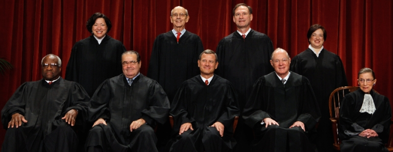 U.S. Supreme Court members (first row L-R) Associate Justice Clarence Thomas, Associate Justice Antonin Scalia, Chief Justice John Roberts, Associate Justice Anthony Kennedy, Associate Justice Ruth Bader Ginsburg, (back row L-R) Associate Justice Sonia Sotomayor, Associate Justice Stephen Breyer, Associate Justice Samuel Alito and Associate Justice Elena Kagan pose for photographs in the East Conference Room at the Supreme Court building October 8, 2010 in Washington, DC. (Photo by Chip Somodevilla/Getty Images)