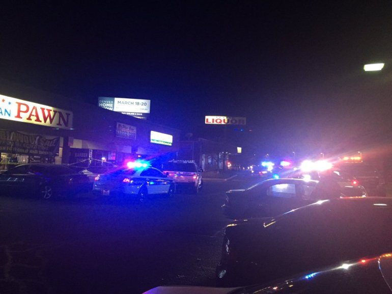Scene after shooting, robbery at All American Pawn