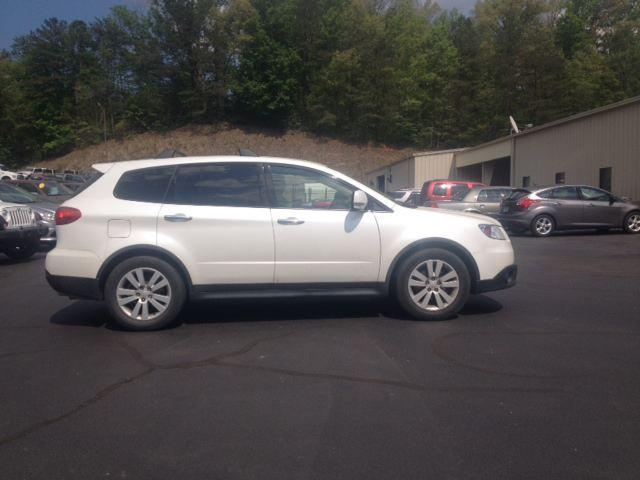 Missing 2009 White Subaru Tribeca, bearing Colorado license plate 080QTA