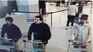 "Three explosions ripped through the Belgian capital of Brussels on Tuesday, March 22, 2016 killing dozens of people and wounding over 170 more, according to Belgian media. This is a picture released by Belgian Police of suspects in the Belgium attacks. IT SAYS : ""Wanted #TERRORISM Who recognizes this man?"