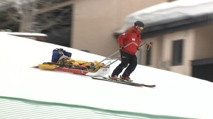 Ski patrol team member takes an injured person down the mountain at Steamboat