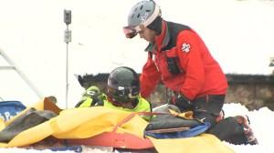 Steamboat ski patrol team members assists an injured skier