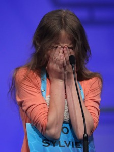 Sylvie Lamontagne of Lakewood covers her face as she tries to spell her word in the finals of the 2016 National Spelling Bee on May 26, 2016 in Washington. (Photo: Alex Wong/Getty Images)