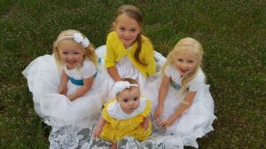 4-year-old Heidi Miller survived a crash with a train. She is on the far right in the photo. The crash near Trinidad, Colo. killed her parents and three sisters.