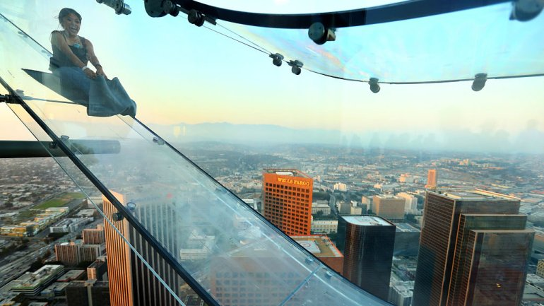 A guest rides the SkySlide in Los Angeles, California. (Photo: Mark Davis/Getty Images for Ogilvy PR)