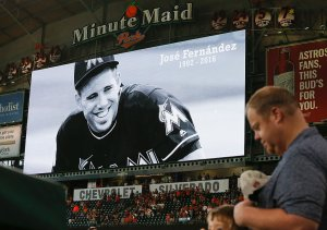 Houston Astros fans take a moment of silence in memory of Miami Marlins pitcher Jose Fernandez. (Photo by Bob Levey/Getty Images)