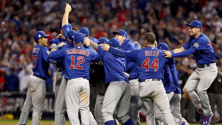The Chicago Cubs celebrate after defeating the Cleveland Indians 8-7 in Game Seven of the 2016 World Series on November 2, 2016 in Cleveland, Ohio. (Photo: Elsa/Getty Images)