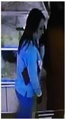 The female suspect is described as a white woman in her 20s, with dark hair.
