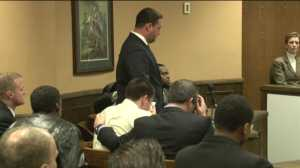 Trent Mays (seated, middle) holds a tissue to his face after learning of the guilty verdict.