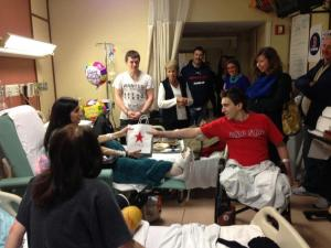 Jeff Bauman delivers a gift to Sydney Corcoran at Boston Medical Center. (Photo Credit: Celeste & Sydney Corcoran Support Page)