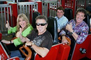 """Former """"Brady Bunch"""" kids Susan Olsen, Christopher Knight and Barry Williams give the Racer the 'thumbs up' during a visit to Ohio's Kings Island back in 2013 (Photo Credit: Kings Island)"""