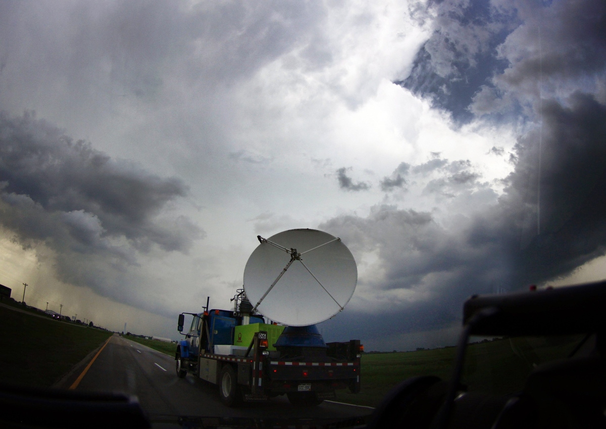 An NOAA's mobile doppler radar mounted on the back of a truck tracks a tornadic thunderstorm passing over Clearwater