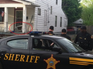 A sheriff's deputy guards a Seymour Avenue home where Amanda Berry, Gina DeJesus and Michelle Knight were found alive on Monday. (Photo Credit: Fox 8 News)