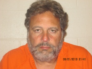 (Jimmy Dimora mug shot taken 8/21/2013; Cuyahoga County Jail)